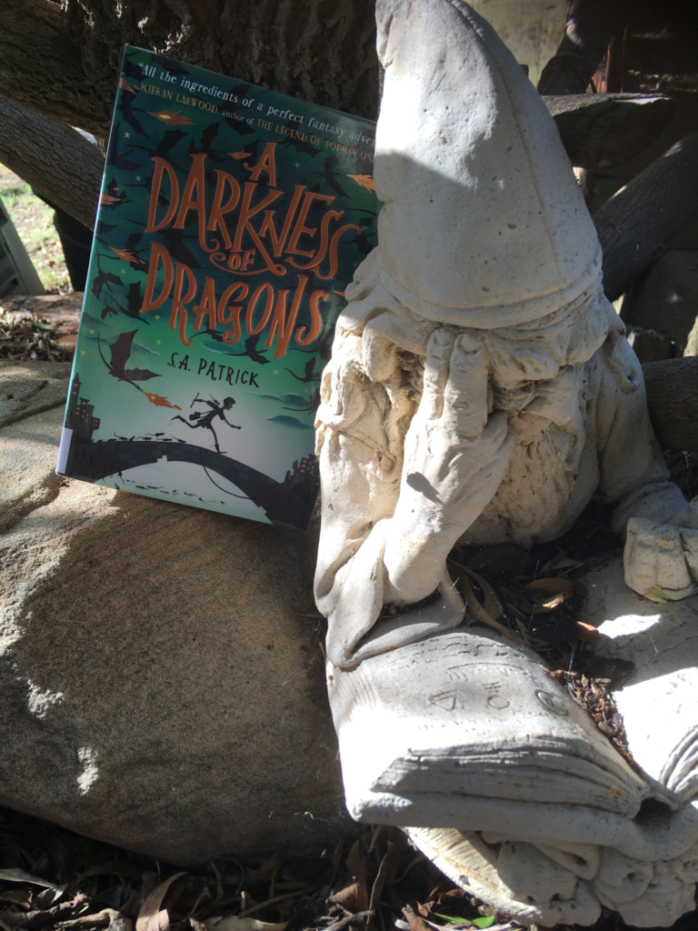 Book Review: A Darkness of Dragons (Songs of Magic #1) by