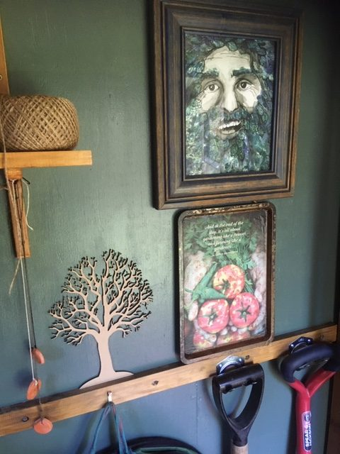 The potting shed wall with a portrait of Costa Georgiadis by Adelaide artists Joan and Rose.
